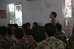 An Afghan National Army (ANA) soldier, right, assigned to the 201st Corps, stands to answer a question during an ANA-led training course at Forward Operating Base Gamberi in Laghman province, Afghanistan 130617-A-XM609-015.jpg