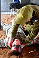 An Israeli soldier, right, treats a U.S. Soldier with simulated wounds during a medical exercise for Austere Challenge 2012 in Beit Ezra, Israel 121022-F-QW942-041.jpg