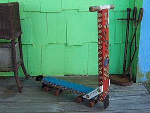 Kick scooter - Wooden scooter with a pair of roller skates