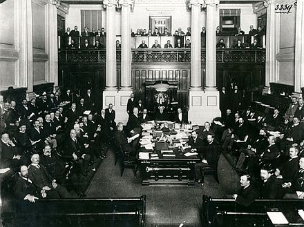 Australia's first prime minister, Edmund Barton at the central table in the House of Representatives in 1901. Australian House of Reps 1901.jpg
