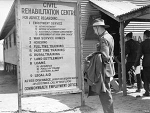 Demobilisation of the Australian military after World War II - An Australian Army sergeant reads the sign outside a civil rehabilitation centre in Melbourne during March 1946