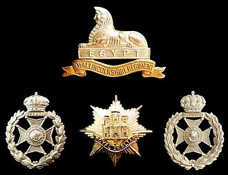 Bermuda Volunteer Rifle Corps - Badges of the Bermuda Volunteer Rifle Corps (left), the Bermuda Rifles (as the BVRC was retitled between 1951 and 1965, right), the Royal Lincolnshire Regiment (top), and its successor, the Royal Anglian Regiment (bottom-centre)