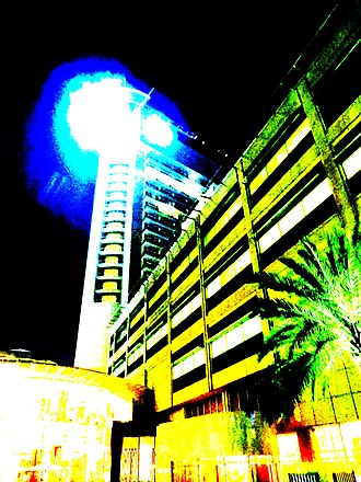Beach Rotana - Painting of the Beach Rotana hotel tower at night.