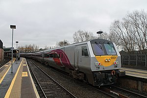 Coaching stock of Ireland - Enterprise DVT No. 9001 at Belfast Central in the new purple livery