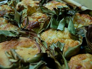 Bibingka - Bibingka Galapong cooked with slices of salted egg with toppings of grated coconut and kesong puti.