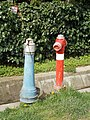 Blue water well and Red fire hydrant, 2018 Visegrád.jpg