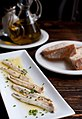 Boquerones white anchovy with bread and olive oil.jpg