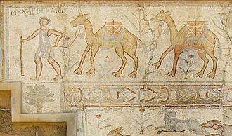 Camel train - Ancient Roman mosaic depicting a merchant leading a camel train. Bosra, Syria