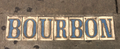 Bourbon Street sign in sidewalk.png