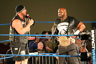 Aces & Eights - Bully Ray (President) and Devon (Sgt. at Arms) as World Heavyweight and Television Champions