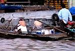Bumpy waters on Vietnam's Mekong Delta (9147970943).jpg