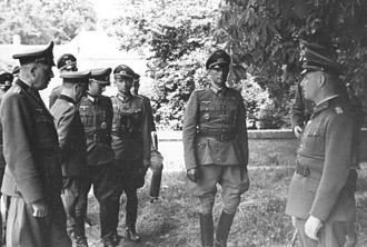Friedrich Dollmann - Dollmann (left) in conversation with Lieutenant-General Edgar Feuchtinger (2nd from right) and Rommel, France 1944