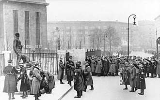 Rosa-Luxemburg-Platz - German policemen lay a wreath on the monument to Captains Anlauf and Lenck during the Day of the German Police, January 16, 1937. In 1951, Erich Mielke, one of the murderers, ordered the demolition of the monument.