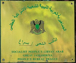 "Politics of Libya under Muammar Gaddafi - Plaque denoting the ""Peoples' Bureau"" (Embassy) of ""Socialist People's Libyan Arab Great Jamahiriya"" in Prague"