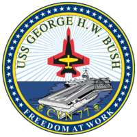 Military Escalation: Phase Two of the War on Libya  200px CVN 77 insignia