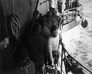 Operation Teardrop - Kapitänleutnant Just comes aboard USS Bogue after being rescued