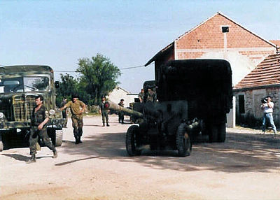 Croatian soldiers capture a Serb cannon and truck in the Miljevci plateau incident, June 21, 1992 Captured Serb cannon and truck in Siritovci 1.jpg