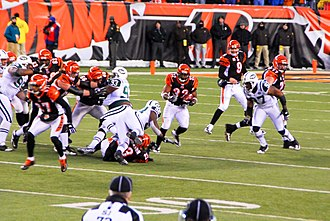Cedric Benson - Benson running after taking a handoff from Carson Palmer against the New York Jets in the 2009–10 AFC Wild Card Game.