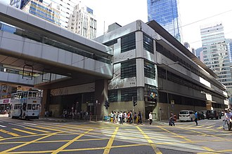 Central Market, Hong Kong - Corner of Des Voeux Road Central and Jubilee Street, with a section of the Central Elevated Walkway, in 2015.