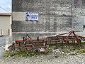 Charrues Route des Échets (Mas Rillier) et panneau Leader Price.jpg
