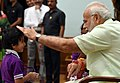 Children tying 'Rakhi' on the Prime Minister, Shri Narendra Modi's wrist, on the occasion of 'Raksha Bandhan', in New Delhi on August 26, 2018 (3).JPG