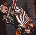 Chris Auxer on accordion Sweden December 2010.jpg