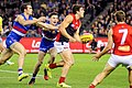 Christian Petracca handballing away from Easton Wood and Toby McLean.jpg