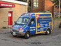 Coach USA Sprinter van with MegaBus ad.jpg