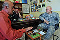 Coalition and Iraqi police forces team up to distribute micro-grant funds to assist local farmers DVIDS180624.jpg