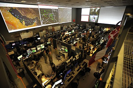 The US Combined Air and Space Operations Center (CAOC) at Al Udeid Air Base provides command and control of air power throughout Iraq, Syria, Afghanistan, and 17 other nations. Combined Air Operations Center 151007-F-MS415-019.jpg
