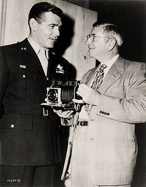 Command Decision (film) - Publicity shot of Gable with the head of the camera department John Arnold.