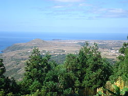 The arid coast of the western portion of the island of Santa Maria, location of the main settlement, Vila do Porto (as seen from Pico Alto)