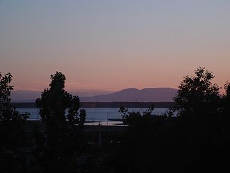 Ship Creek, Alaska - Sunset view of Cook Inlet and Ship Creek, Mount Susitna in background.