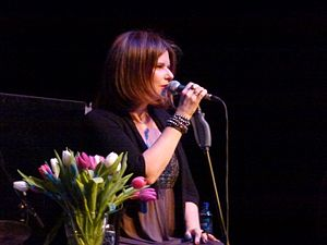 Margo Timmins - Timmins in a 2013 concert at Barbican; visible are the flowers she arranged before the concert to mitigate her stage fright