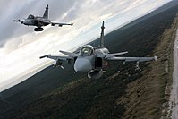 Czech JAS-39 Gripen over the Curonian Spit in 2012.jpg