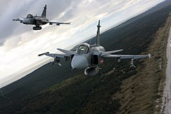 Czech Saab Gripen fighters over the Curonian Spit while participating in the Baltic Air Policing mission in 2012.