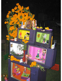 """A Day of the Dead altar in Los Angeles pays homage to """"dead"""" (cancelled) television shows, with traditional marigolds, sugar skulls and candles."""
