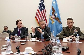 R. Nicholas Burns - Burns and Secretary of Defense Donald Rumsfeld at NATO headquarters in Brussels, on December 2, 2003