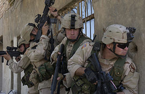 155th Armored Brigade Combat Team - 155th Brigade soldiers shortly before entering a building believed to be occupied by  insurgents in an area of Al Iskandariyah, Iraq, on 5 March 2005