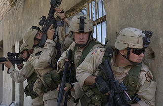 11th Armored Cavalry Regiment - 11th ACR soldiers form-up as they prepare to clear a building known to house insurgents in an area of Iskandariya, Iraq, circa March 2005
