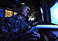 Defense.gov News Photo 100513-N-5082P-008 - U.S. Navy Petty Officer 3rd Class Gregory L. Gray mans his station in the combat direction center aboard the aircraft carrier USS Enterprise CVN 65.jpg
