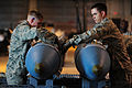 Defense.gov News Photo 100609-F-4583H-235 - U.S. Air Force Senior Airman Joshua Price left and Staff Sgt. Darrell Rinde both from the 28th Munitions Squadron build two training bombs during.jpg
