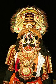 A Yakshagana artist dressed as a Rakshasa or demon