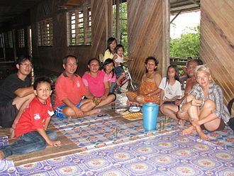 Iban people - An Iban family serving guest tuak.