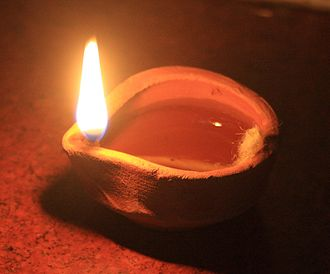 Oil lamp - Simple contemporary Indian clay oil lamp during Diwali
