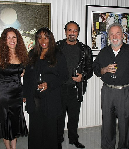 Donna Summer in 2007 with husband Bruce Sudano and her longtime collaborator, Italian composer Giorgio Moroder. On the left Giorgio Moroder's wife Francisca Gutierrez. Donna Summer Bruce Sudano Giorgio Moroder Beverly Hills.jpg