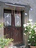 Door with curtains, Castel Giuliano, Bracciano.jpg
