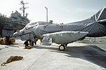 Douglas TA-4J Skyhawk is wrapped in protective covering prior to being loaded aboard USS Okinawa (LPH-3) at NAS Cubi Point, 4 June 1992 (6480685).jpeg