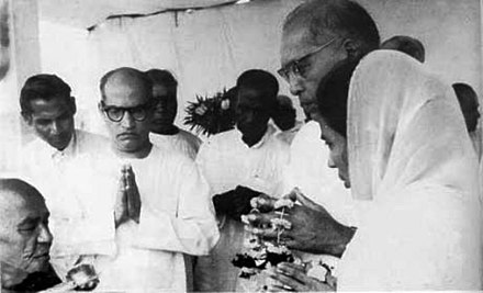 Ambedkar receiving the Five Precepts from Mahasthavir Chandramani on 14 October 1956. In the photograph (from right to left): Savita Ambedkar, B. R. Ambedkar, Wali Sinha and bhikkhu Chandramani. Dr. Babasaheb Ambedkar accepting Dhamma Deeksha - Buddhism from Mahasthavir Chandramani along with Wali Sinha, Rewaramji Kawade and wife Maisaheb on October 14, 1956.jpg