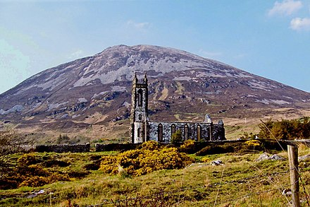 Errigal towers over Gweedore and Cloughaneely. The former Church of Ireland church (now ruined) at Dunlewey can be seen in the foreground. The church was built in the early 1850s. Dunlewy - Derelict church with walled yard and gate - geograph.org.uk - 1190473.jpg